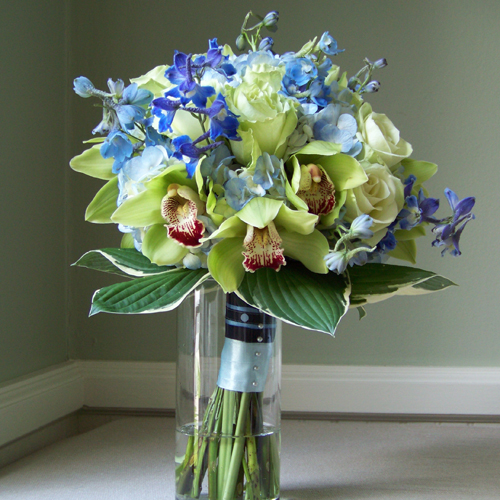 hand-tied bridal bouquet with delphinium, hydrangea, cymbidium orchids, Green Tea roses and variegated hosta foliage