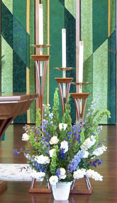 altar arrangement with delphinium, Tibet roses, stock, bells of Ireland and myrtle