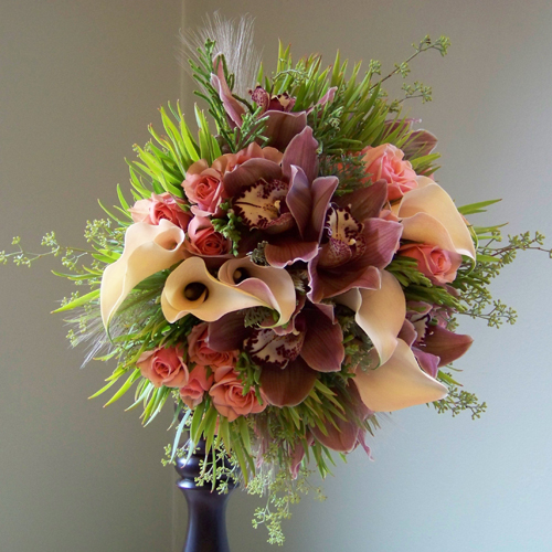 "The bouquet - chocolate cymbidium orchids, Ilse spray roses, Cameo mini callas, berzelia, ""Pisa"" leucadendron, seeded eucalyptus and locally harvested grasses"