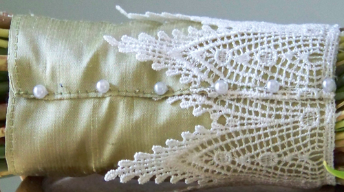 bouquet stem wrap made with lemongrass silk with and an ivory lace overlay