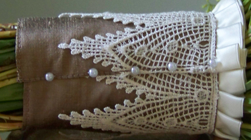 bouquet stem wrap made with antique gold silk, an ivory lace overlay and ivory satin trim