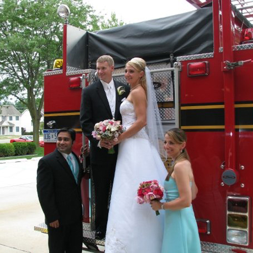 Kori and Eric pose with a fire truck