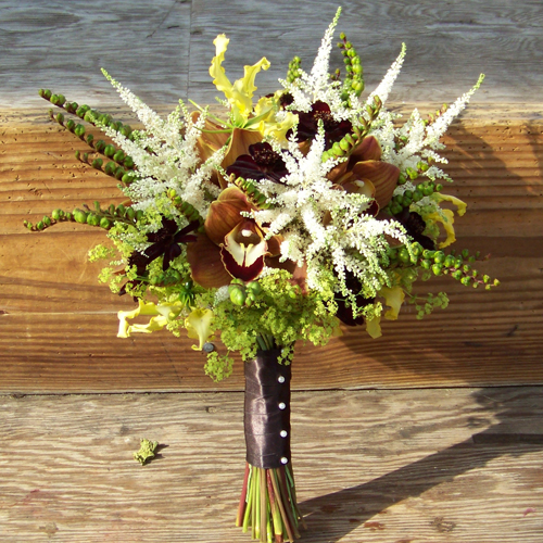 bridal bouquet with chocolate cosmos, chocolate cymbidiums, montbretia pods, alchemilla, yellow gloriosa lilies and astilbe