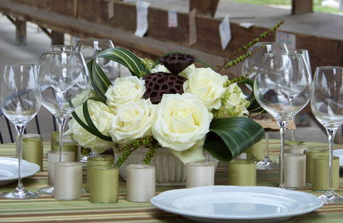 centerpiece with Polar Star roses, variegated aspidistra, montbretia pods, alchemilla, and lotus pods