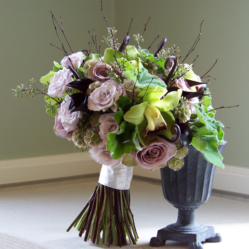 bridal bouquet with bamboo branches, fern curls, Schwartzwalder mini callas, Amnesia roses, Eloquence spray roses, scabiosa pods, seeded eucalyptus, cymbidium orchids and scented geranium