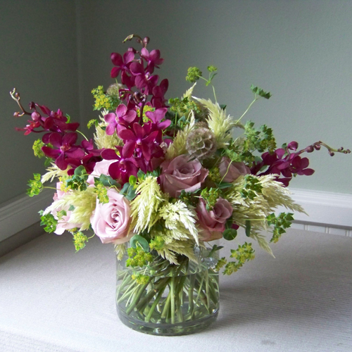 thank you arrangement with mokara orchids, scabiosa pods, Faith roses, feather celosia, and bupleurum
