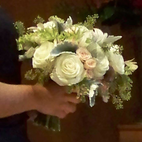The bridal bouquet is held by the maid-of-honor during the ceremony