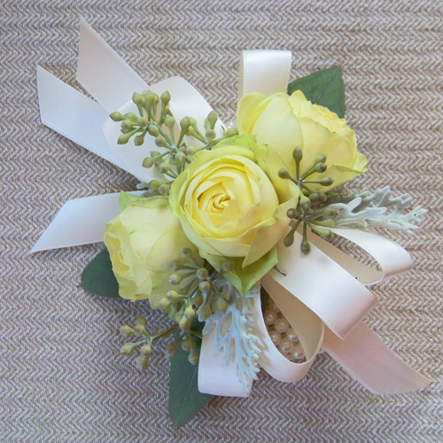 wrist corsages for the mothers had Creamy Eden spray roses, dusty miller and seeded eucalyptus mounted on a Fitz corsage bracelet