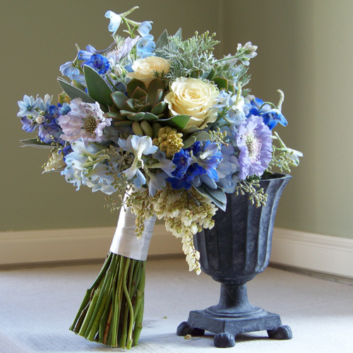 bridal bouquet containing delphinium, blue scabiosa, tweedia, hydrangea, pieris, tuberose, Cream Prophyta roses, seeded eucalyptus, silver tree, wormwood, and succulents by Floral Verde LLC