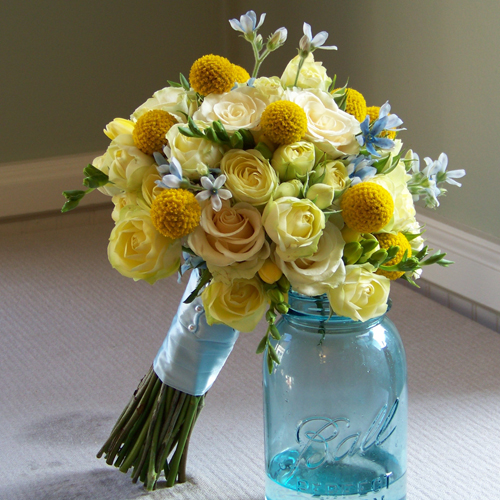 bridesmaids bouquets with craspedia, Creamy Eden spray roses, Cream Prophyta roses, light yellow freesia and tweedia