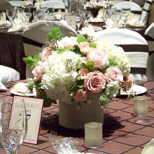 low centerpiece with Charming Unique and Sweet Akito roses, Dali spray roses, hydrangea, scabiosa, scented geranium, and seeded eucalyptus