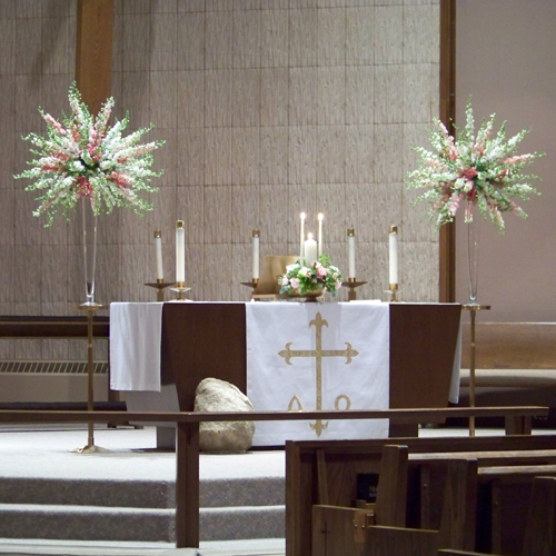 altar arrangements with pink and white snapdragons and larkspur