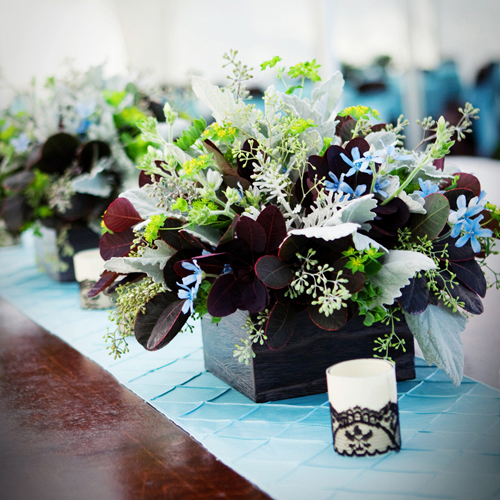 centerpiece with cotinus, tweedia, dusty miller, seeded eucalyptus, and bupleurum in a wooden box