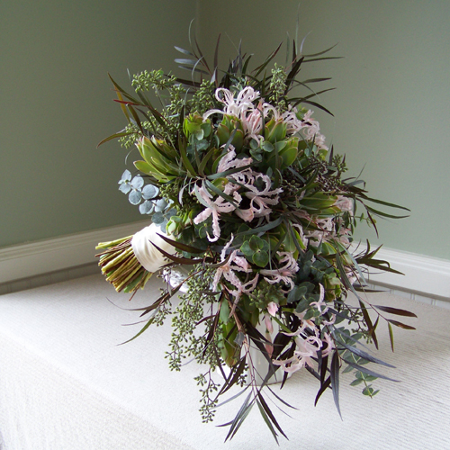 hand-tied cascade with blush nerine lilies, agonis, baby blue eucalyptus, seeded eucalyptus, and green leucadendron