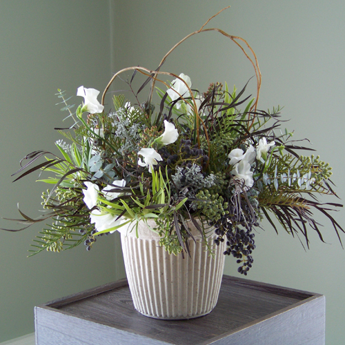 Centerpiece with agonis, privet berries, white sweet peas, green leucadendron, grevillea, seeded eucalyptus, baby blue eucalyptus, silver bell eucalyptus, kochia and curly willow