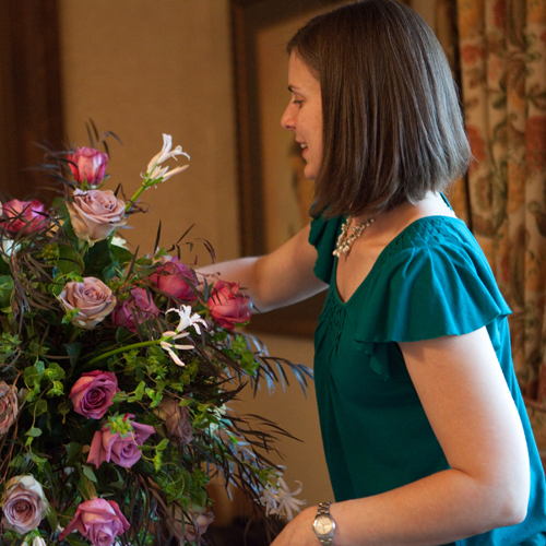 action shot of Janet arranging flowers
