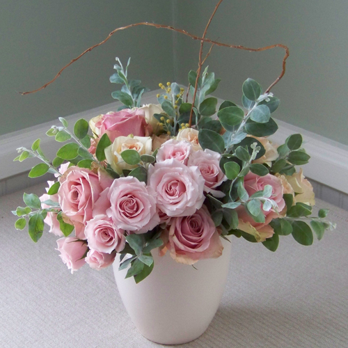 Valentine's Day arrangement with Eos roses, Chablis and Majolika spray roses, acacia and curly willow