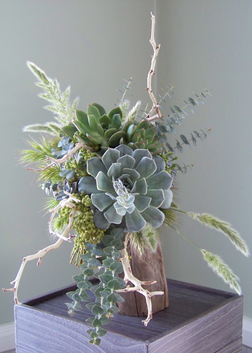 bridal bouquet with manzanita branches, assorted succulents, berzelia, baby blue eucalyptus, bunny grass, and other assorted grasses
