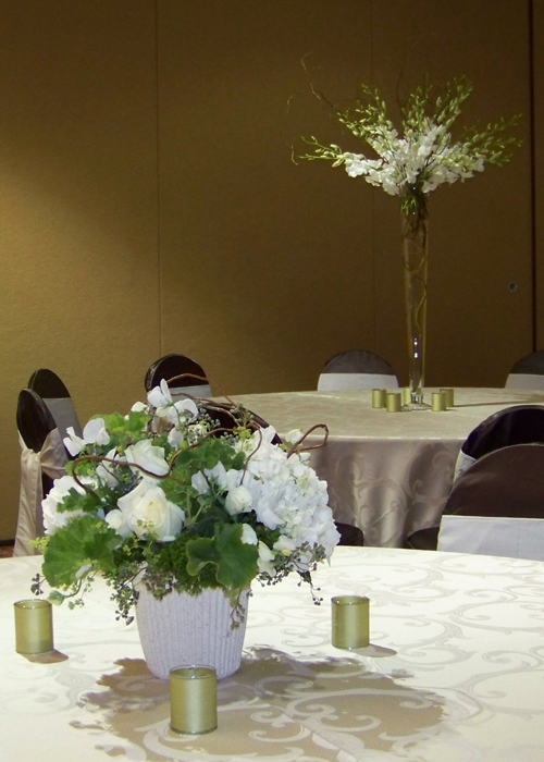 Low garden centerpiece and tall dendrobium orchid centerpiece at the Holiday Inn Gateway Centre