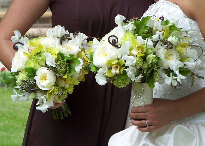 green and ivory bouquets with sweet peas, Patience garden roses, fern curls, curly willow, pieris buds, green hydrangea, green mini cymbidiums, scented geranium, seeded eucalyptus, Super Green roses, and green minou spray roses
