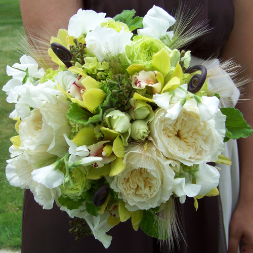 bridesmaid bouquet with white sweet peas, Patience garden roses, fern curls, green hydrangea, green mini cymbidiums, scented geranium, native grasses, seeded eucalyptus, Super Green roses, and green minou spray roses