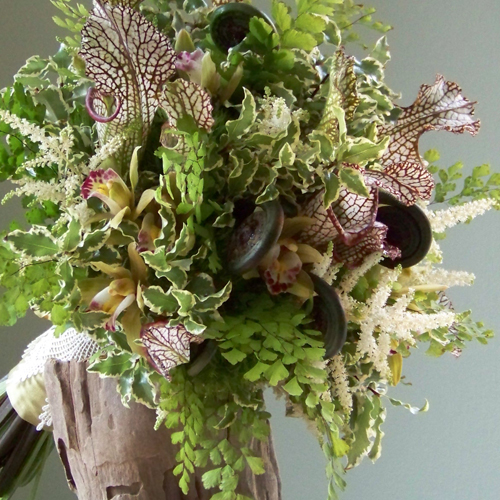 hand-tied bouquet with green fern curls, sarracenia trumpets, white astilbe, green mini cymbidiums, Green Tric dianthus, mini variegated pittosporum and maidenhair fern