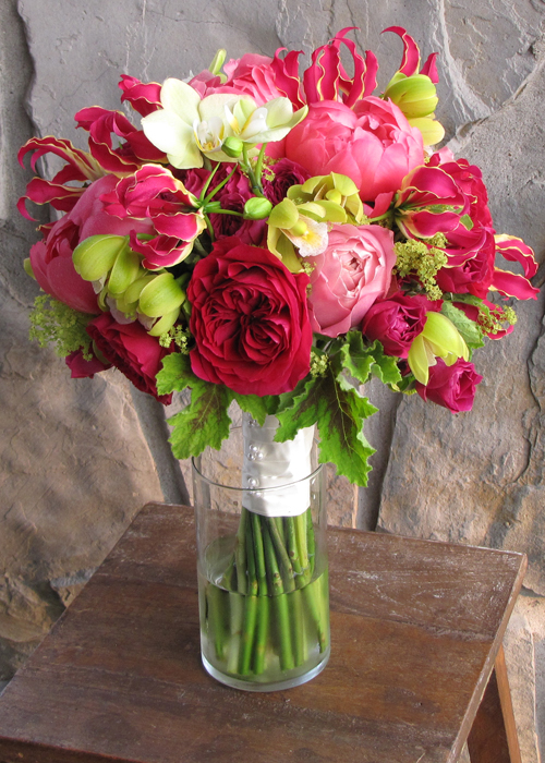 bridal bouquet with David Austin Darcey garden roses, Hot Majolika spray roses, gloriosa lilies, Coral Charm peonies, Romantic Antike garden roses, green mini cymbidium orchids, green Phalaenopsis orchids, alchemilla and scented geranium