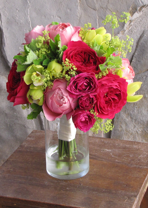 bridesmaid's bouquet with David Austin Darcey garden roses, Hot Majolika spray roses, Romantic Antike garden roses, green mini cymbidium orchids, alchemilla and scented geranium
