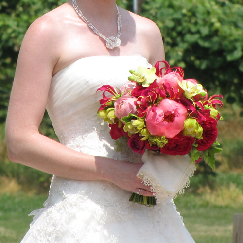 An antique handkerchief was attached to the bouquet handle.