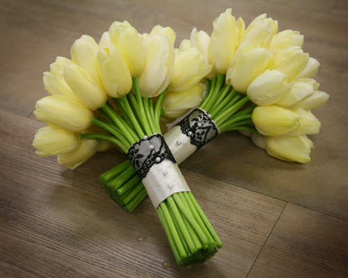 bridesmaids' bouquets with ivory Maureen French tulips and a black lace and ivory satin stem wrap