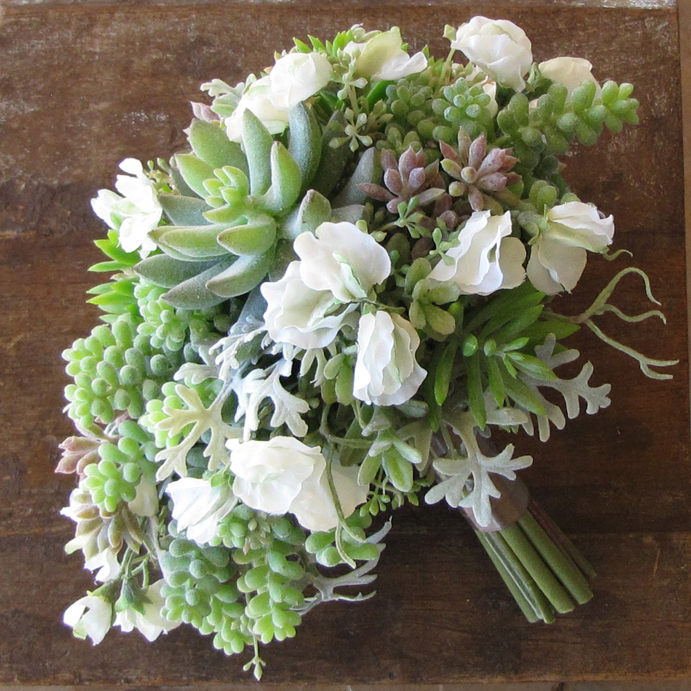 Silk cascading bridal bouquet with white sweet peas, echeveria, sedum, donkey tail, seeded eucalyptus, and dusty miller