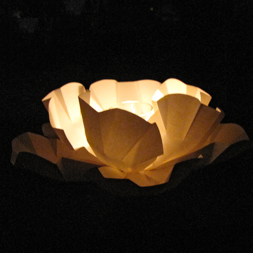 large ivory paper peony pool float with candle