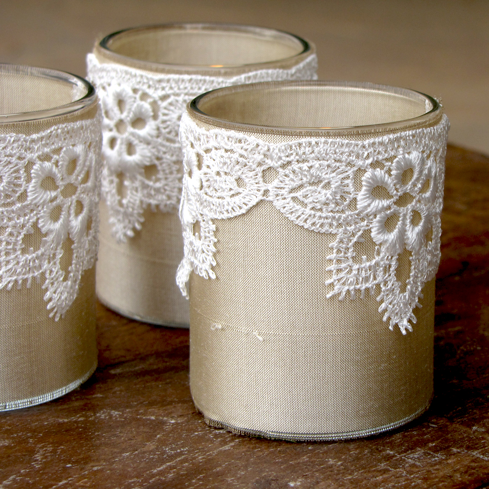 ivory silk and white lace wrapped votive glasses, perfect for your wedding