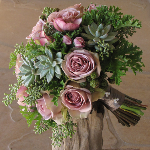 Hand-tied bridal bouquet with lavender hellebores, Amnesia roses, blackberries, Pachyveria glauca 'Little Jewel', seeded eucalyptus, and scented geranium, finished with a fawn satin wrap