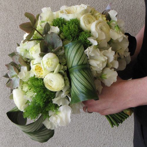 Hand-tied bridal bouquet with echeveria 'Mensa', pink/beige hellebores, calathea, jade trachelium, green hydrangea, Antique Romantica garden spray roses, cream ranunculus, and ivory Japanese sweet peas
