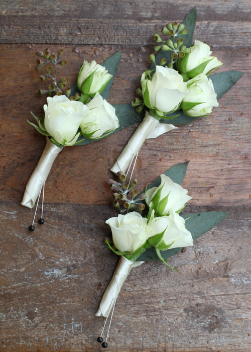 boutonnieres for the family with Snow Flake spray roses and seeded eucalyptus