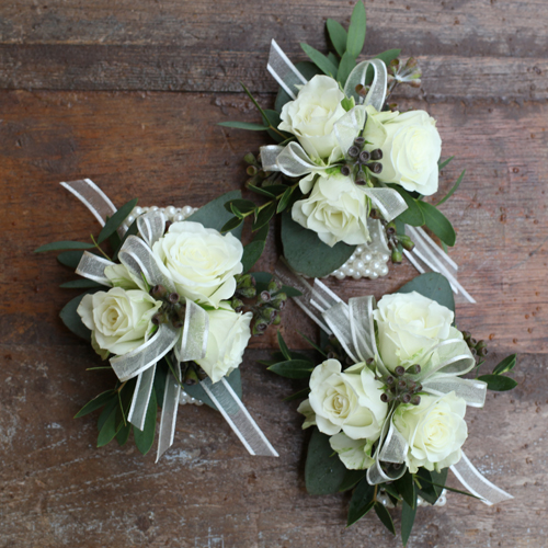 corsages for the family with Snow Flake spray roses, seeded eucalyptus and gunnii eucalyptus on pearl wristlets