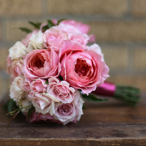 bridesmaid bouquet with Romantic Antike garden roses, Star Blush spray roses, Majolica spray roses, White Majolica spray roses and jasmine vine, by Floral Verde LLC