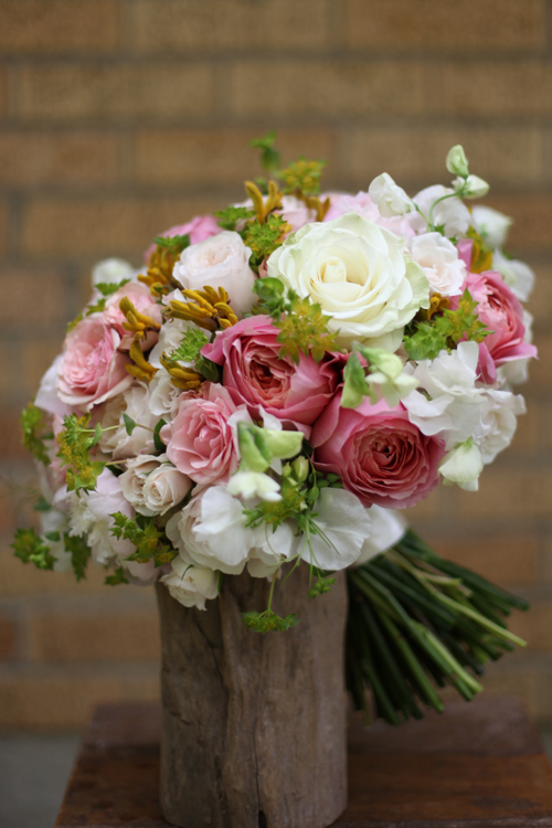 bridal bouquet with Romantic Antike garden roses, Star Blush spray roses, Keira garden roses, blush peonies, White Majolica spray roses, white sweet peas, Mondial roses, bupleurum and yellow kangaroo paws, for a ceremony in Indian Hill, Ohio, by Floral Verde LLC