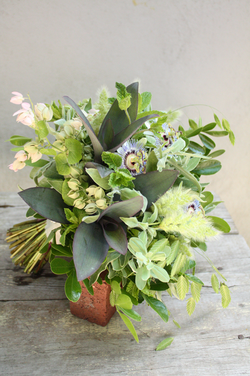mint green bouquet with passion flowers, coral vine, bunny grass, northern sea oats, mint, sage, Purple Heart Wandering Jew, and Mountain Laurel