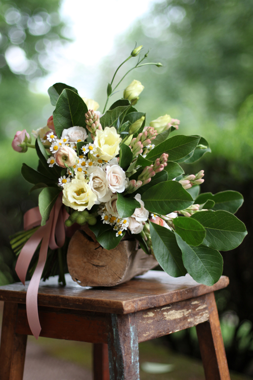 bridal bouquet with cream lisianthius, chamomile, White Majolica spray roses, tuberose, peach ranunculus and magnolia foliage, by Floral Verde LLC