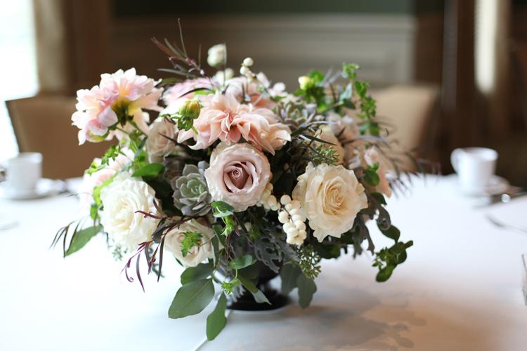Centerpieces with White Mikado spray roses, Quicksand roses, Sahara roses, Café au lait dahlias, Mondial roses, Echeveria 'Lola', dusty miller, gunnii eucalyptus, seeded eucalyptus, grape ivy, buplerum and agonis, by Floral Verde LLC, at Ivy Hills Country Club in Cincinnati, OH.