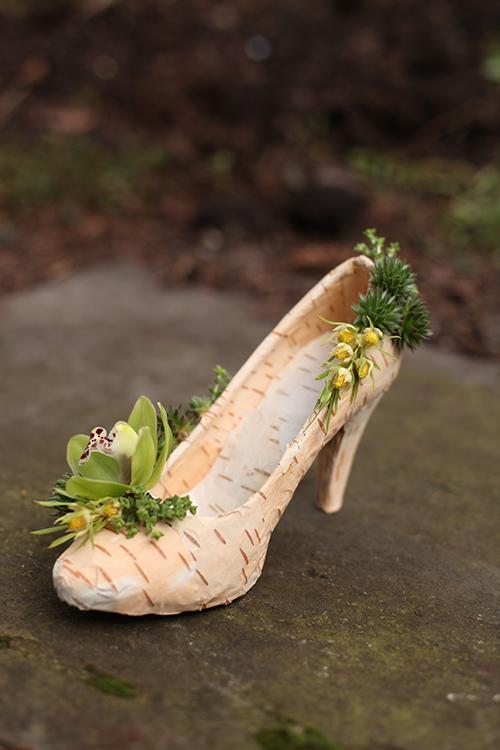 Floral shoe with birch bark, succulents, mini crassula, mini leucadendron, and a mini green cymbidium orchid, by Floral Verde LLC in Cincinnati, OH.