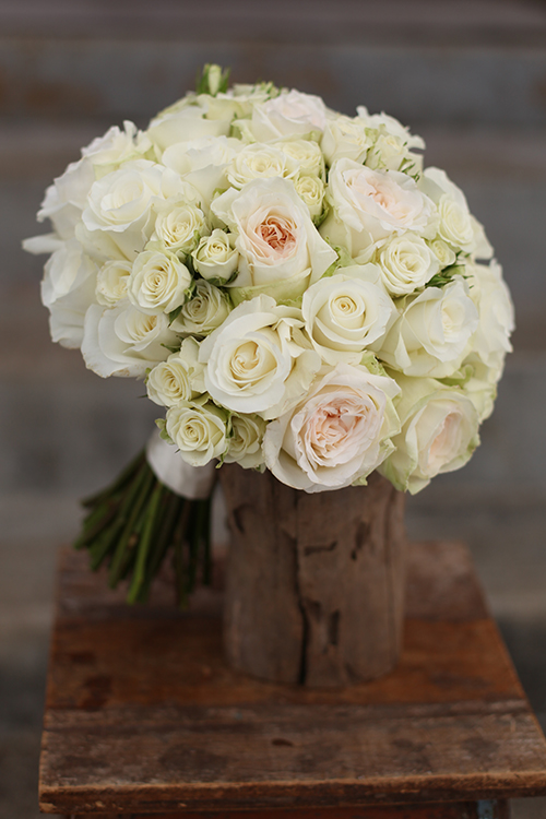 Classic white bridal bouquet with White O'hara garden roses, Akito roses and Snow Flake spray roses, for a wedding at St. Clare Chapel, by Floral Verde LLC in Cincinnati, OH.