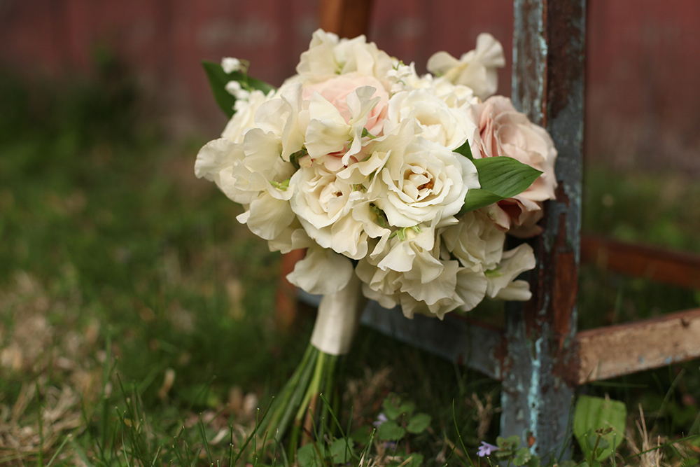 mother of the bride bouquet by wedding florist Floral Verde LLC in Cincinnati, Ohio; with gardenia, lily of the valley, White Majolica spray roses, Quicksand roses and ivory Japanese sweet pea