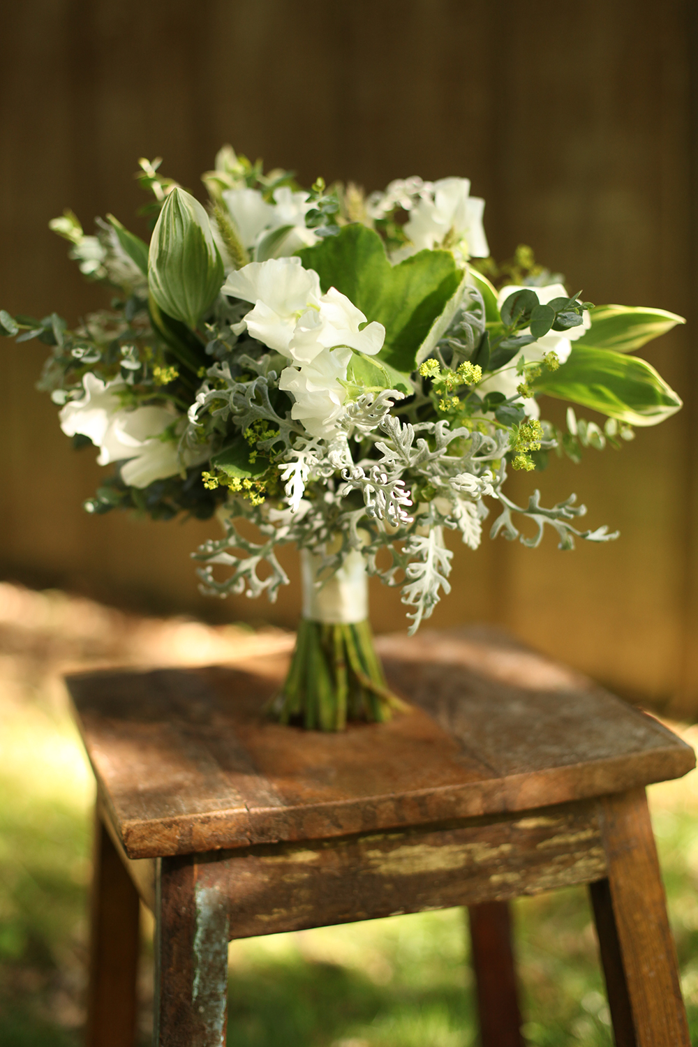 bridesmaid bouquet by wedding florist Floral Verde LLC in Cincinnati, Ohio; with white Japanese sweet pea, bunny tail grass, alchemilla, variegated Solomon's Seal., scented geranium, gunnii eucalyptus, baby blue eucalyptus and dusty miller.