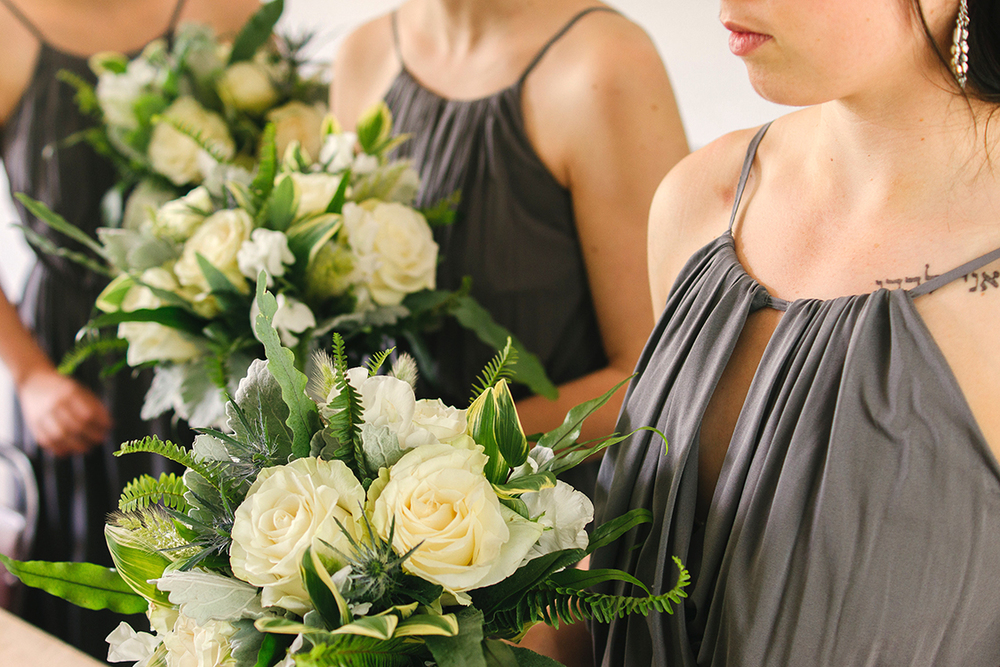 Bridesmaids' bouquets with white sweet pea, eryngium, dusty miller, blue star fern, bunny tail grass, fern, kangaroo fern and variegated Solomon's Seal. By Cincinnati wedding florist Floral Verde.
