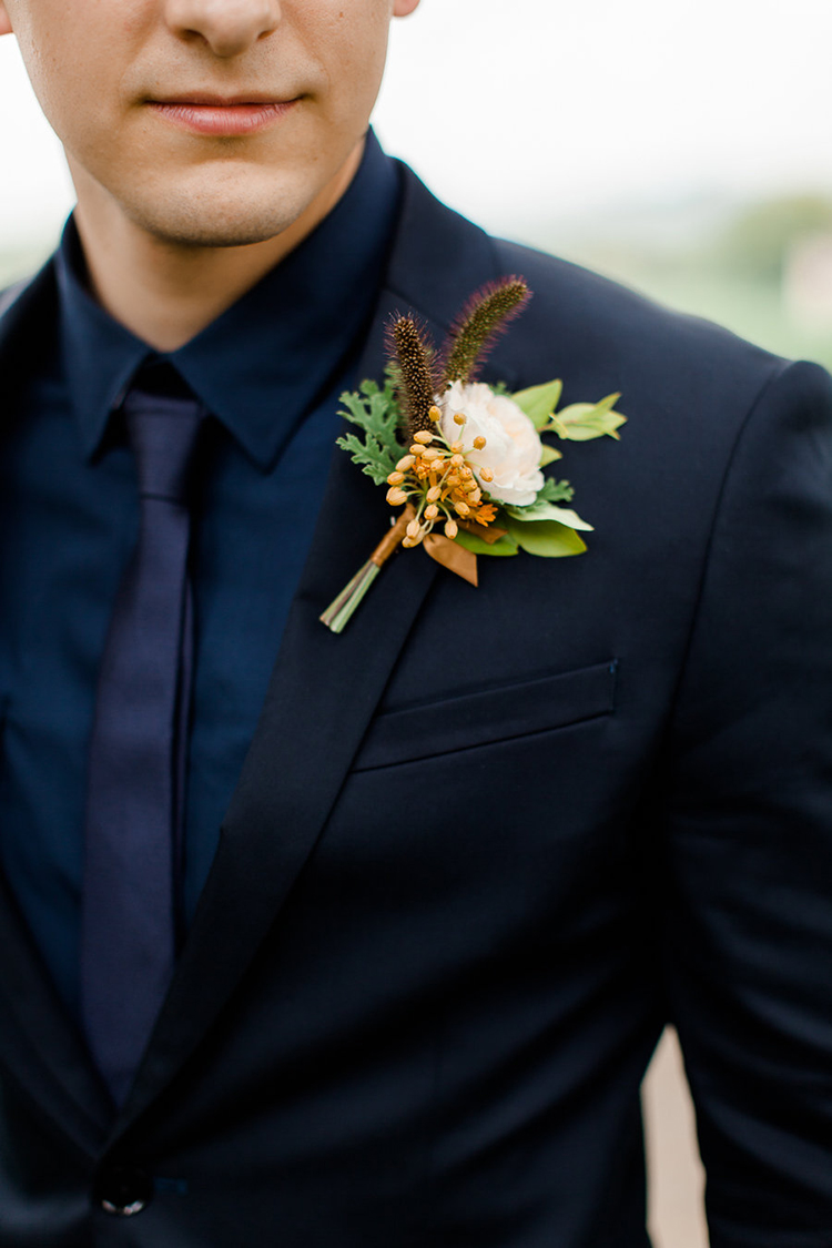 Garden rose and asclepias boutonnniere by Cincinnati florist Floral Verde. Image by Jenny Haas Photography.