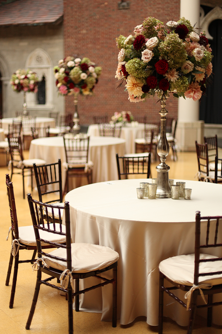Tall blush and burgundy centerpieces at The Dayton Art Institute, by Cincinnati wedding florist Floral Verde.