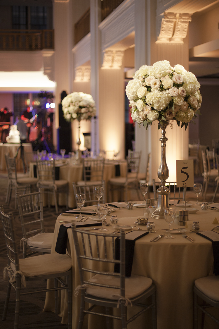 Tall white and blush centerpiece at The Renaissance Cincinnati Hotel, by Cincinnati wedding florist Floral Verde.